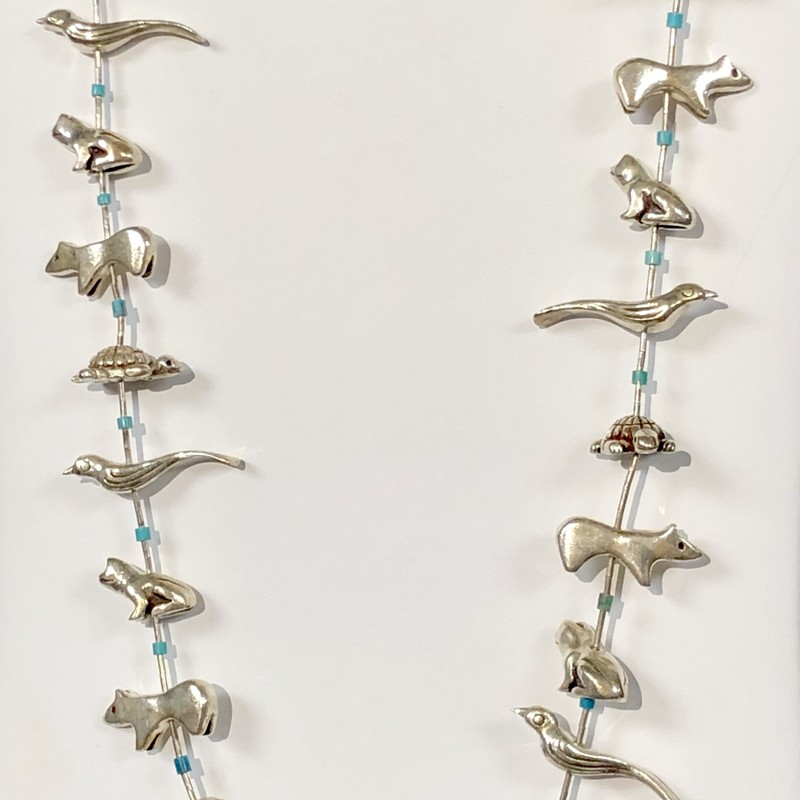 "Native American Fetish Necklace featuring Sterling Silver Animals<br /> Pre-Owned, Excellent Condition<br /> 27.5"" long<br /> Animals are birds, frogs, bears, turtles, each separated by sterling silver beads and one turquoise bead.<br /> *Shipping includes Insurance*"