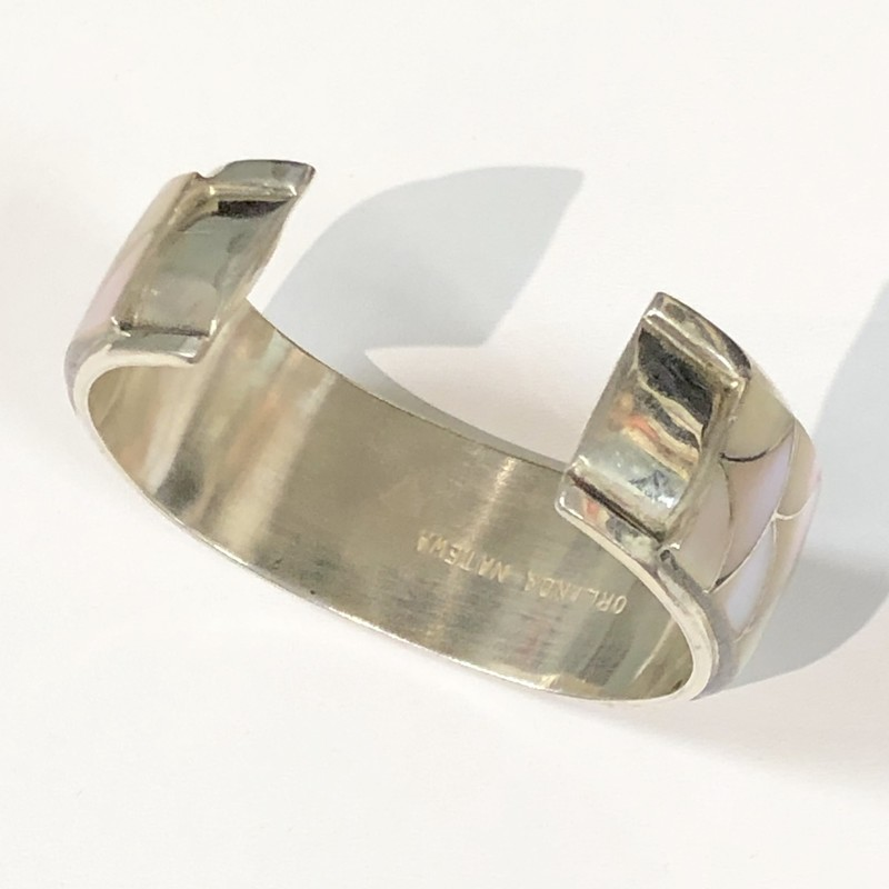 "Zuni Tribe Orlinda Natewa Sterling Silver, Mother of Pearl Inlay Cuff Bracelet.<br /> -Pre-Owned, Excellent Condition.<br /> -Measures 13/16"" thick with a 1-3/16"" open gap. Inner  circumference measures approximately 6-1/4""  (including gap)<br /> -Signed: ORLINDA NATEWA<br /> *Shipping includes Insurance*"