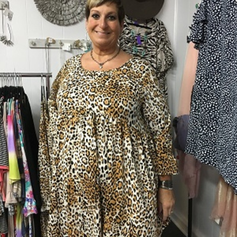 Our Ruffled Leopard Print Dress is now available and looks AMAZING on. You can wear this for any occasion. Dress it up or dress it down. The material is made of 96% Polyester & 4% Spandex with a length of 38 in.