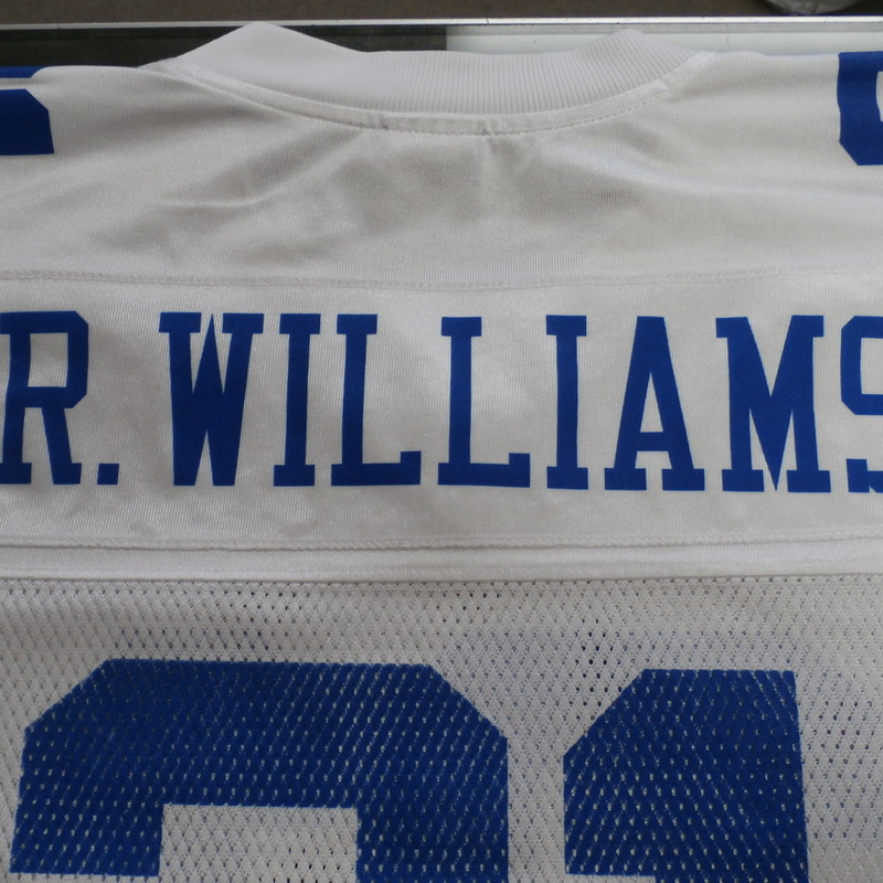 "Reebok Men's Dallas Cowboy's Roy Williams Jersey size Medium white #32735<br /> Rating:   (see below) 3- Good Condition<br /> Team: Dallas Cowboy's<br /> Player:  Roy Williams<br /> Brand: Reebok<br /> Size: Men's   Medium (Measured Flat: across waist 22"", length 29"" )<br /> Measured flat: armpit to armpit; top of shoulder to the bottom hem<br /> Color: white & blue<br /> Style: Football Jersey; screen printed;<br /> Material:   100% polyester<br /> Condition: - 3- Good Condition - wrinkled; minor pilling and fuzz; shows light signs of wear;<br /> Item #: 32735<br /> Shipping: FREE"