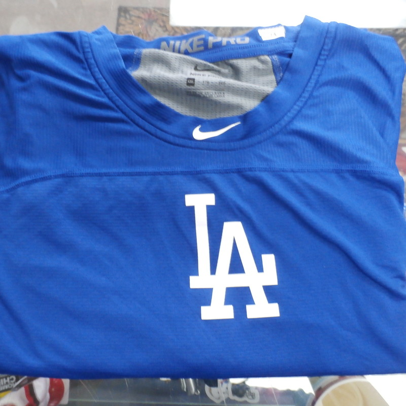 "Nike Men's LA Dodgers shirt size 2XL blue #32887<br /> Rating:   (see below) 3- Good Condition<br /> Team:  LA Dodgers<br /> Player:  Team<br /> Brand: Nike<br /> Size: Men's 2XL (Measured Flat: across waist 23"", length 30"" )<br /> Measured flat: armpit to armpit; top of shoulder to the bottom hem<br /> Color: blue<br /> Style: short sleeve; shirt;screen pressed;<br /> Material:   84% polyester 16% spandex<br /> Condition: - 3- Good Condition - wrinkled; minor pilling and fuzz;<br /> Item #: 32887<br /> Shipping: FREE"