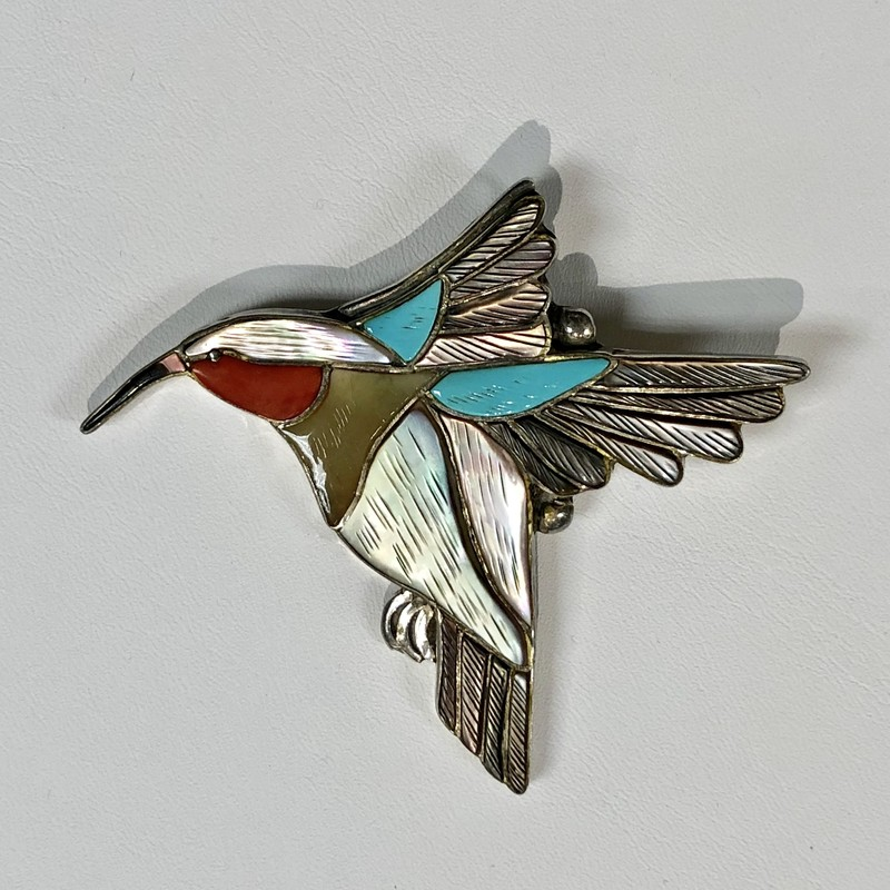 "Native American Zumi Hummingbird Pin and Enhancer, Signed ""Virgil & Shirley Benn""<br /> Pre-Owned, Excellent Condition<br /> Intricate and Exquisite Craftmanship!<br /> Sterling Silver with inlays of turquoise, coral, mother of pearl, & black onyx.<br /> Measures 2-3/8"" wide x 2-3/8"" high overall<br /> *Shipping includes Insurance*"