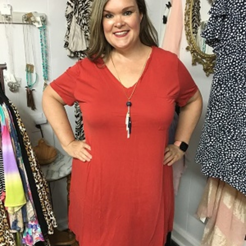 Umgee V-Neck T-Shirt Dress in Red is really comfortable.  You can throw a pair of leggings on with this or go with out.  You can wear this for any occasion.  It is really soft and really stretchy.  It is made out of 65% Cotton and 35% Polyester.  It is 36 inches long.