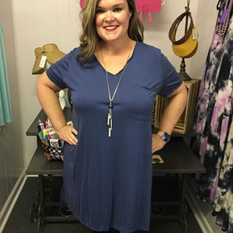 Umgee V-Neck T-Shirt Dress in Blue is really comfortable.  You can throw a pair of leggings on with this or go with out.  You can wear this for any occasion.  It is really soft and really stretchy.  It is made out of 65% Cotton and 35% Polyester.  It is 36 inches long.