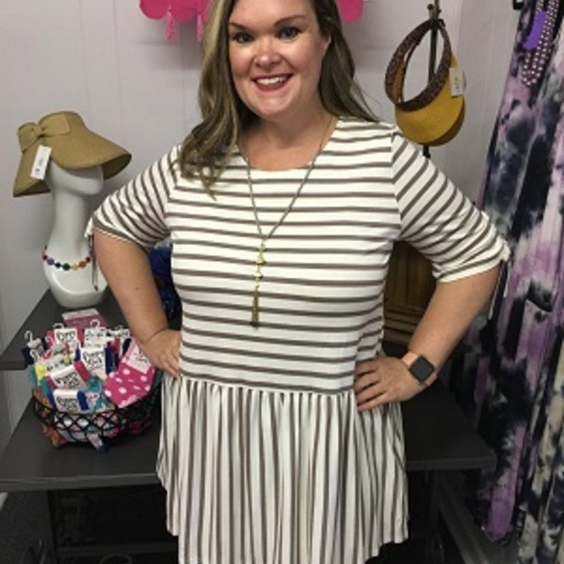 Stripe Print Babydoll Tunic in Coco is beautiful on.  You can wear this with your favorite pair of leggings or capris.  You can put this on and be comfortable all day long.  This is super stretchy.  It is made out of 95% Rayon and 5% Spandex.  It is 32 inches long.