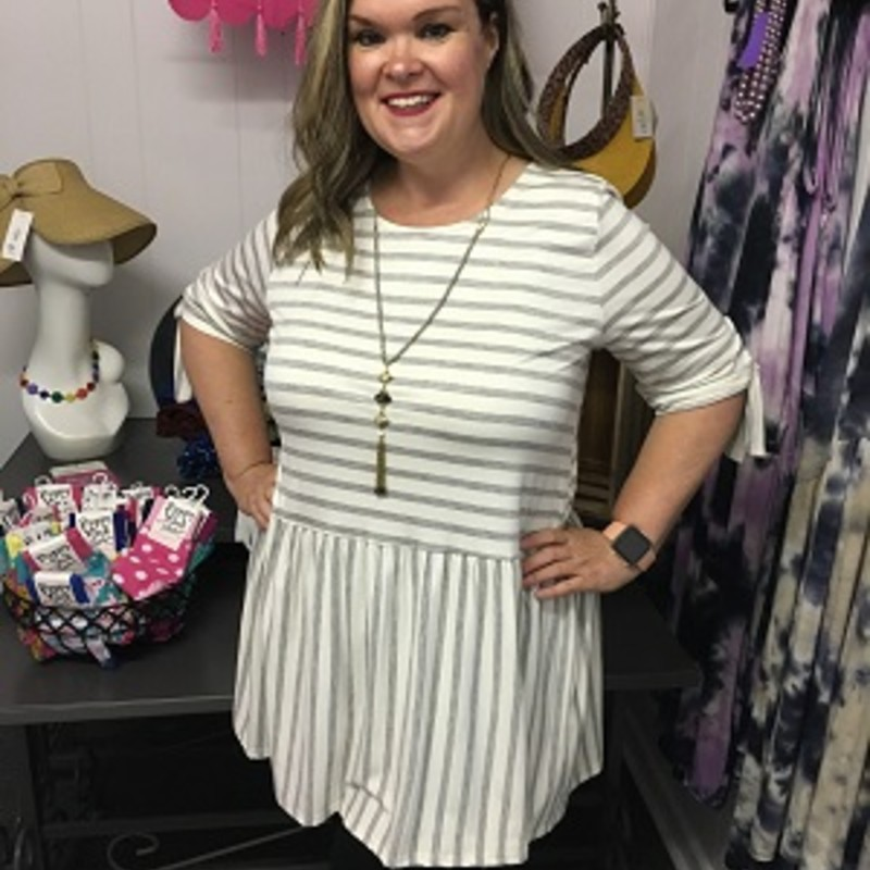 Stripe Print Babydoll Tunic in Heather Grey is beautiful on.  You can wear this with your favorite pair of leggings or capris.  You can put this on and be comfortable all day long.  This is super stretchy.  It is made out of 95% Rayon and 5% Spandex.  It is 32 inches long.