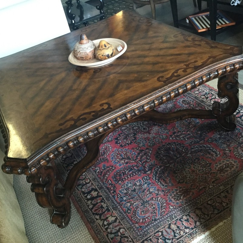 Maitlan&Smith coffee table details include swirly legs, inlaid wood designs on top and beaded edges! Size: 52.52.22