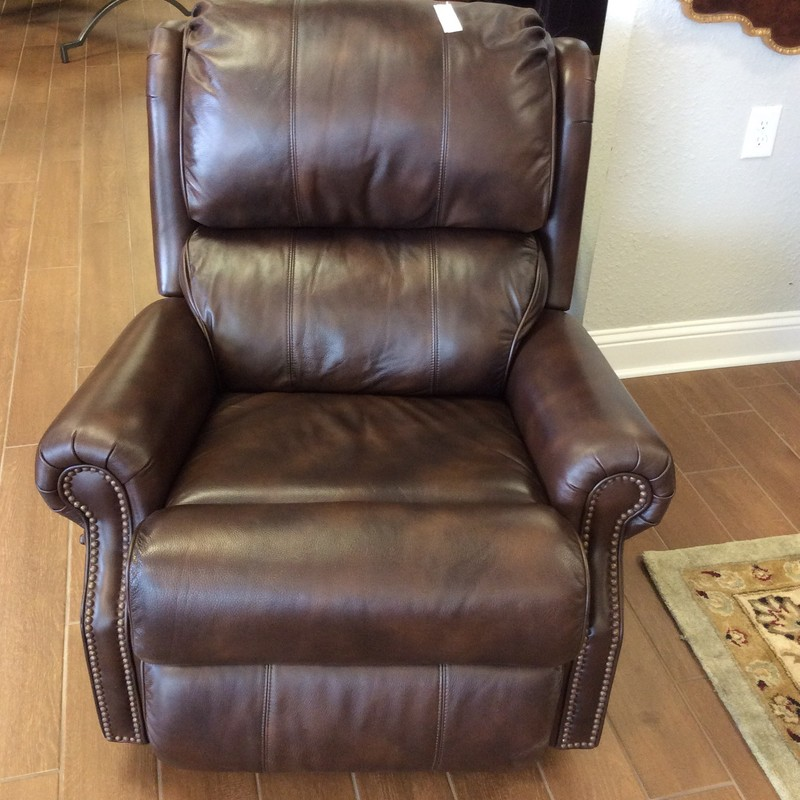 WOW, this gorgeous FLEXSTEEL rocker/recliner is only 6 weeks old and it looks it. It features butter soft, high grade, brown leather and is VERY COMFORTABLE! There is a side lever to both raise and lower the foot rest. Purchased brand new for $1400, means it's a steal at $795!