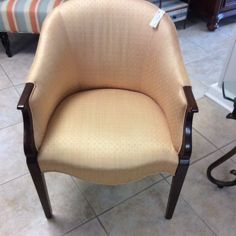 This elegant and dainty HICKORY club chair is in fabulous condition. The solid wood frame has a dark mahogany finish. The delicate upholstery is a light peachy/apricot color with tiny dusty blue and white details. It's very comfy, too!