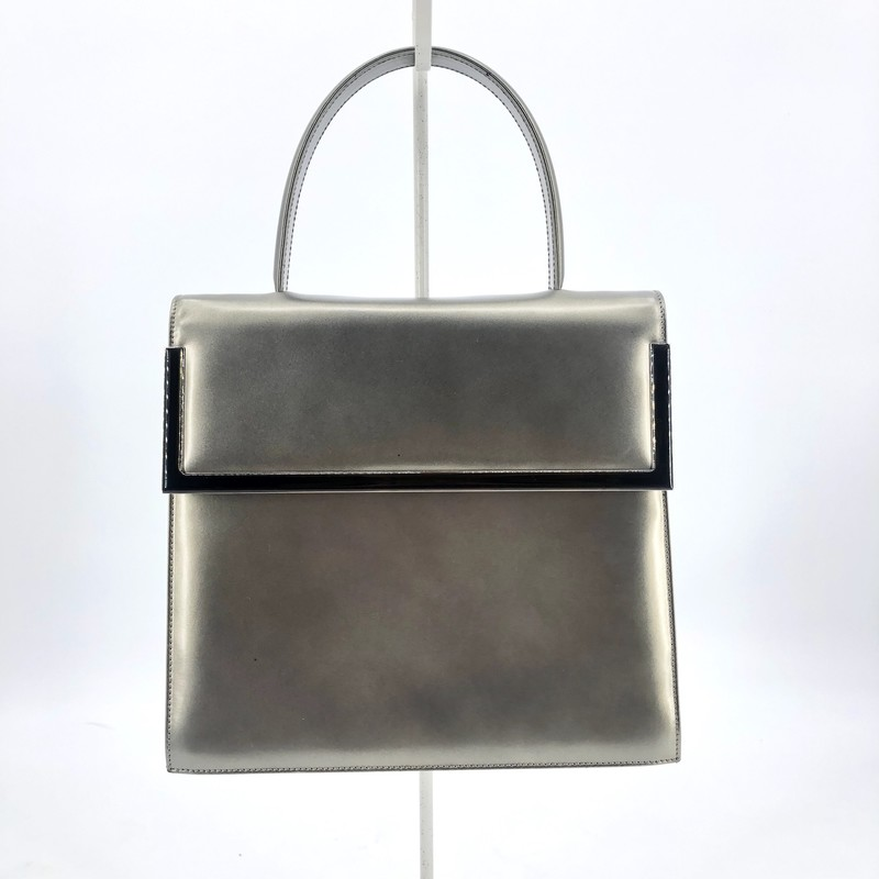 "Salvatore Ferragamo matte platinum leather top handle bag<br /> <br /> 8.5"" H<br /> 10"" W<br /> 3"" D<br /> 5"" Strap drop"