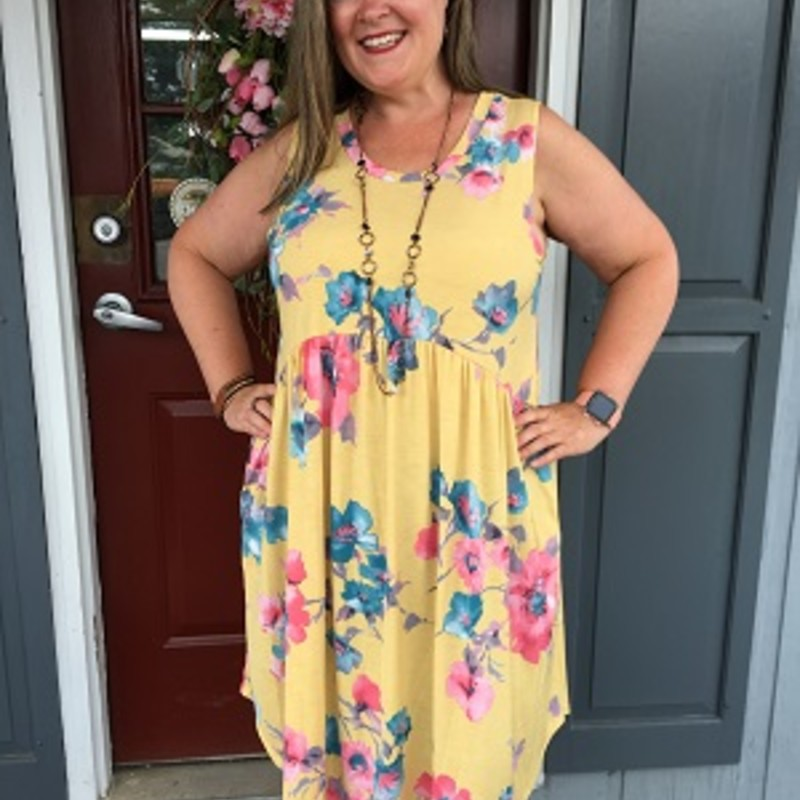 Floral Print Pocket Dress in Yellow is pretty.   You can wear this any day of the week.  This dress is amazing to take on a weekend away it is a throw and go dress (No Wrinkles). This has a lot of stretch. It is made out of 92% Polyester and 8% spandex. It is 39 inches long.