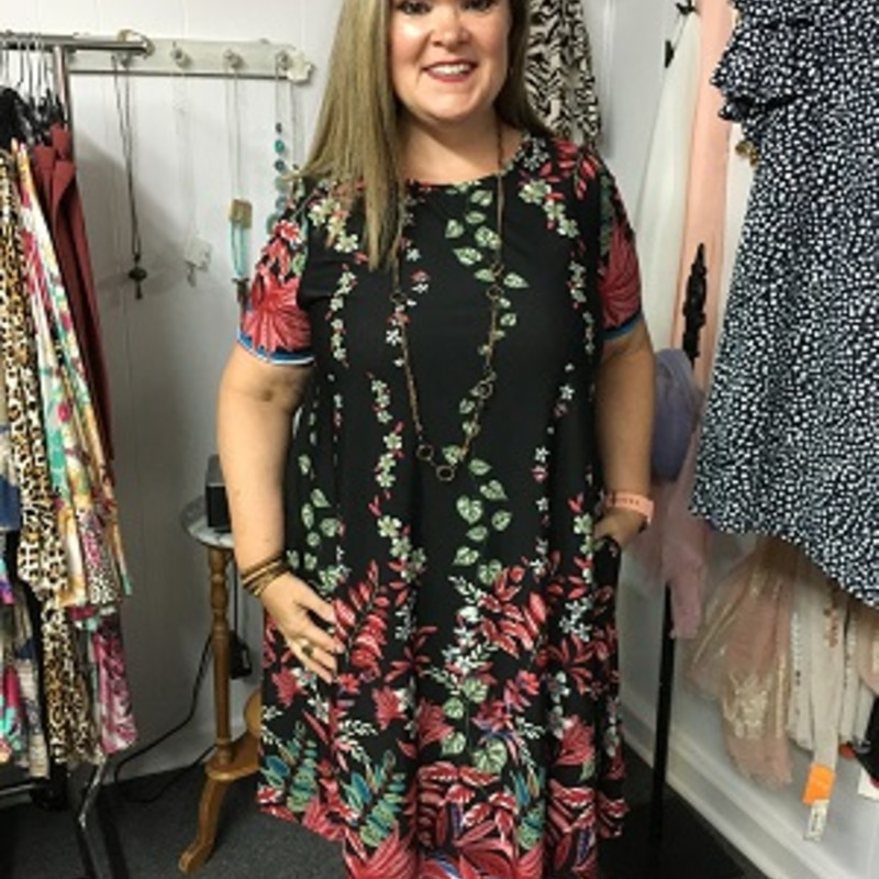 Leaf Print Pocket Dress is beautiful.  This is a throw and go dress (no wrinkles).  It is great for a vacation.  You can wear this with jewelry or with a pair of sneakers.  It is made of 95% Polyester and 5% Spandex.  It is 40.5 inches long.