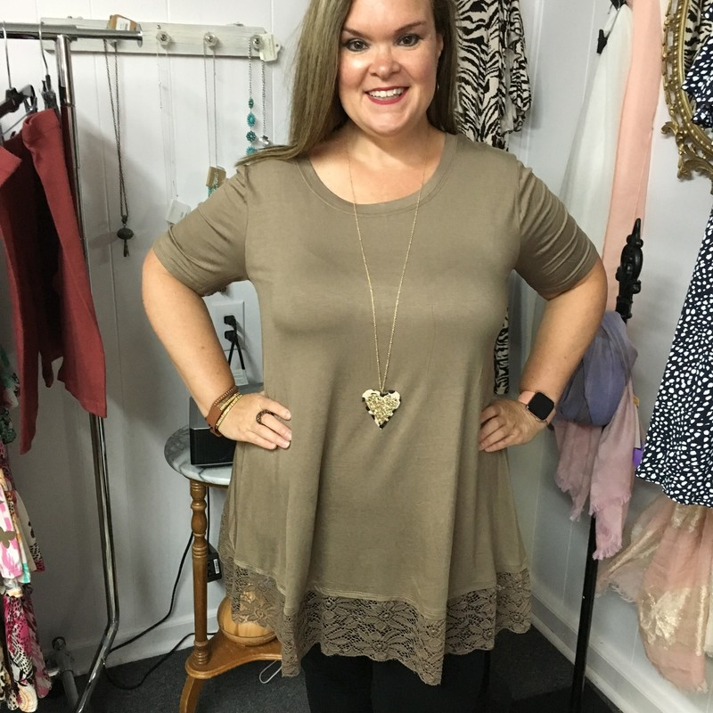 Zenana Lace Bottom Top in Mocha is Beautiful.      You can wear this with leggings, capris, or jeans.  You can wear this for any occasion.  The material has a lot of stretch.  It is made of 93% Rayon and 7% Spandex.  It is 32.5 inches long.