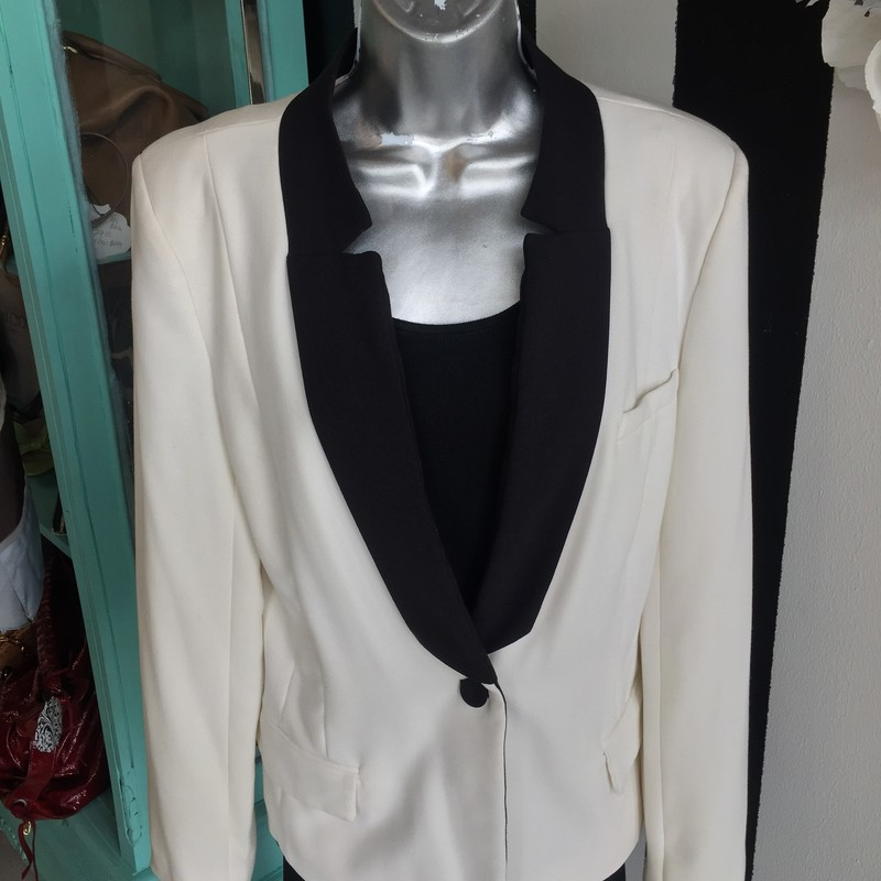 Classy, gorgeous W118 by Walter Baker blazer. Gently used, no missing buttons. One small scuff mark on right arm (shown in photos). White with black detail/buttons and nude interior. Size large. Dry clean only. Retail approx: $249