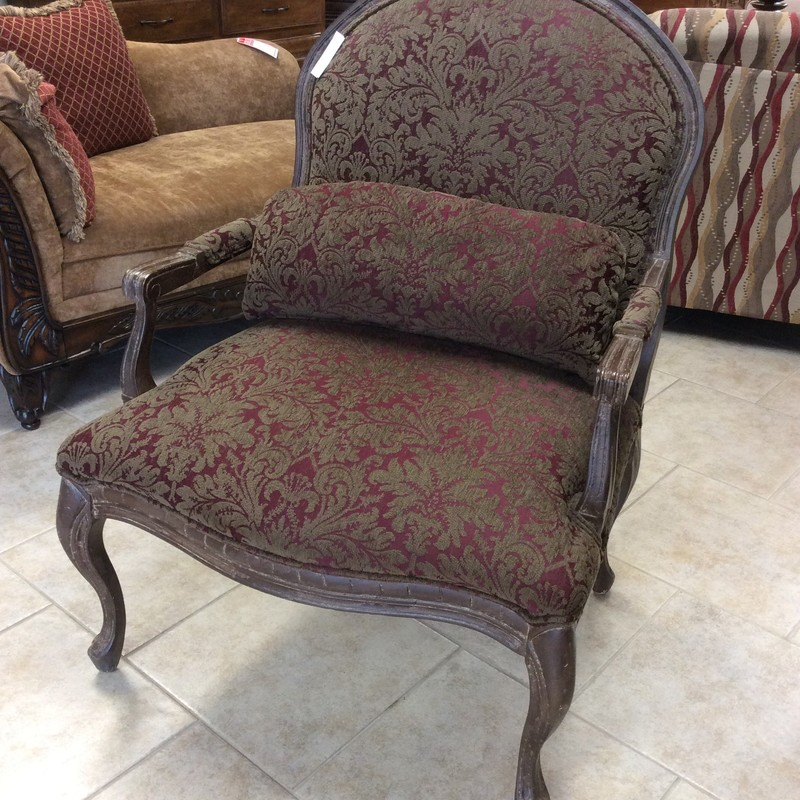 In need of a single chair?  This one may be exacty what you're looking for!  A little oversized and traditional in style it features lovely carved and distressed  wood with a burgundy and brown floral/scroll patterned upholstery giving it a romantic, timeless look. It's in good condition too.