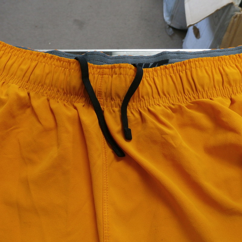 "Nike Men's Tennessee Volunteers shorts Orange Size Large #33393<br /> Rating: (see below) 4- Fair Condition<br /> Team:  Tennessee Volunteers<br /> Player: Team<br /> Brand: Nike<br /> Size: - Men's Large (Measured Flat: Across waist 15"", length 23""; inseam 10"")<br /> Measured flat: hip to hip; hip to hem; and groin to hem<br /> Color: orange<br /> Style: ; embroidered; drawstring; elastic waist;  shorts;<br /> Material: 86% Polyester 14%spandex<br /> Condition: 4- Fair Condition - wrinkled; minor pilling and fuzz; minor stretching from use; there is staining throughout the shorts ;<br /> Item #: 33393<br /> Shipping: FREE"