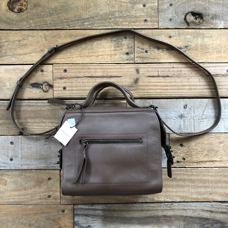 "NWT Kooba Leather Crossbody Bag<br /> Color: Taupe<br /> Size: 8.5"" x 7"" x 5""<br /> <br /> Features:<br /> -zippered closure<br /> -exterior zippered pocket<br /> -interior zippered pocket<br /> -adjustable removable crossbody strap"