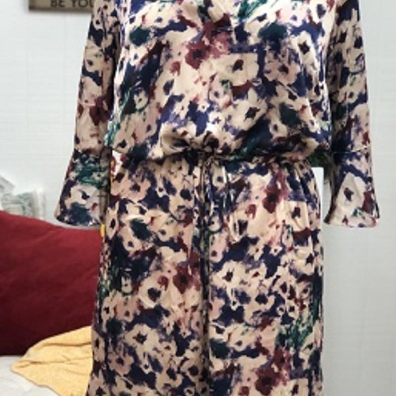 Ralph Lauren Multi Color Dress is GORGEOUS.  It is a size 14W.  It has ruffle 3/4 length sleeve.  It ties around the waist. It is fully lined.   This can be worn for any occasion.  It is made of 100% Polyester.  It is 42 inches long.