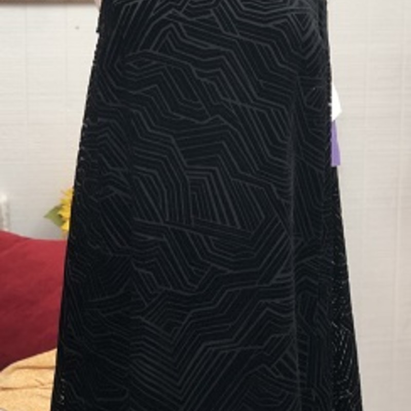 Alfani black dress is perfect for anyone's closet.  It is a 2 piece dress.  It has the liner inside of it.  It has a black velour design on the outside.  This is a BEAUTIFUL dress.  This can be anyone's perfect little black dress.  It is made of 61% Rayon & 39% Nylon.  It is 39 inches long.