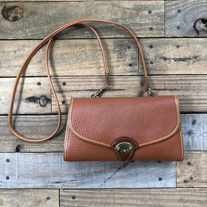 "Vintage Dooney & Bourke Crossbody Bag<br /> Color: Brown<br /> Size: 10.5"" x 6.5"" x 1.5""<br /> <br /> Features:<br /> -removeable crossbody strap<br /> -flap closure<br /> -interior pocket<br /> -interior zippered pocket"