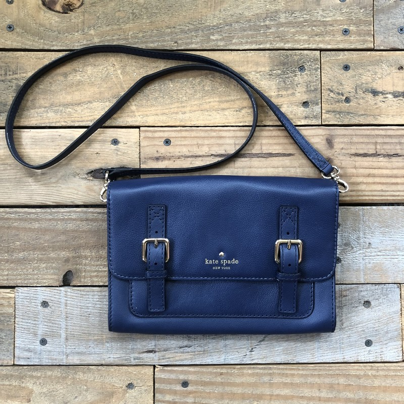 "Kate Spade Leather Crossbody Bag<br /> Color: Navy<br /> Size: 10"" x 7""<br /> <br /> Features:<br /> -flap closure<br /> -interior pocket<br /> -interior zippered pocket<br /> -20.5"" crossbody strap"