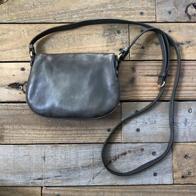 "Marc By Marc Jacobs Leather Crossbody Bag<br /> Color: Gray<br /> Size: 7.5"" x 6"" x 1.5""<br /> <br /> Features:<br /> -adjustable leather crossbody strap<br /> -magnetic flap closure<br /> -zippered pocket on flap<br /> *Includes dust bag<br /> *shows signs of wear on corners"
