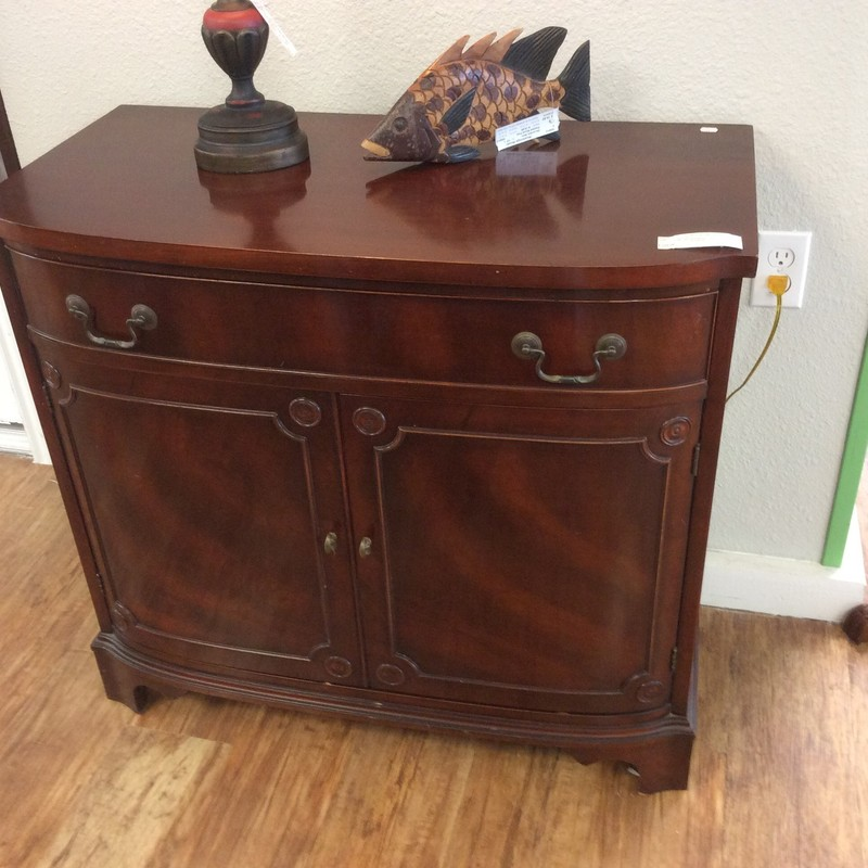 Yep, it's another antique! This MORGANTON silver chest features solid wood construction with a dark cherry finish. There is single roomy drawer, and it has dovetailed jointing. The lower cupboard has a single stationary shelf.