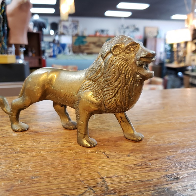 "Walking brass lion, some white patina on head<br /> <br /> 8"" long and 4"" tall<br /> <br /> Call or text the shop for shipping options!"