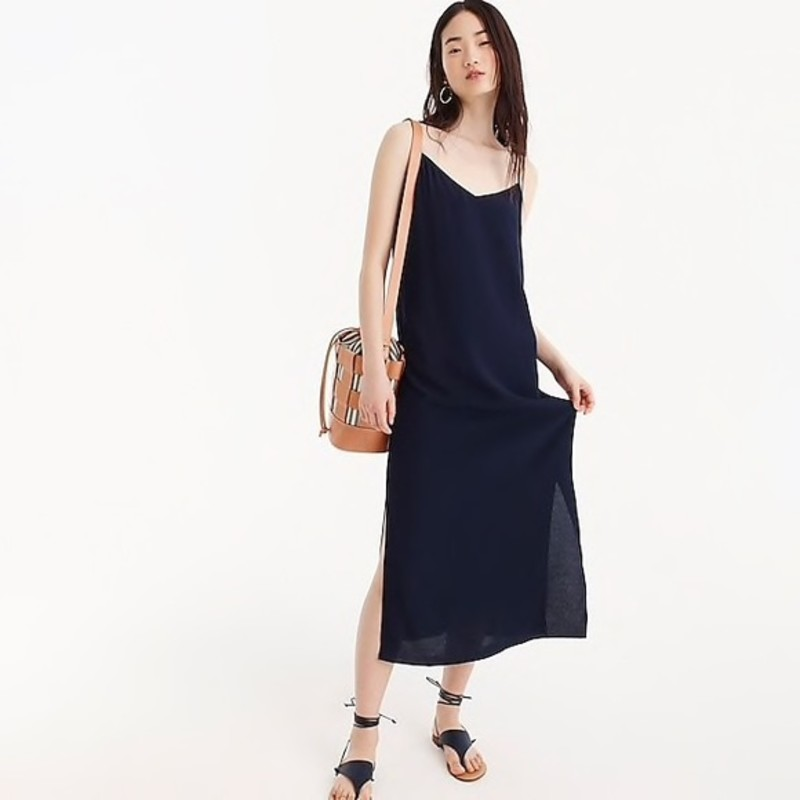 "like new J. crew Midi slip dress, size 2, navy.<br /> <br /> ""Every closet needs one—the perfect slip dress. Bonus: This midi dress is crafted from a drapey fabric (translation: it's nice and airy for summer soirees) and it has cool side slits as a fun added detail.<br /> <br />     Viscose.<br />     Dry clean.""<br /> <br /> photo and description credits: jcrew.com"