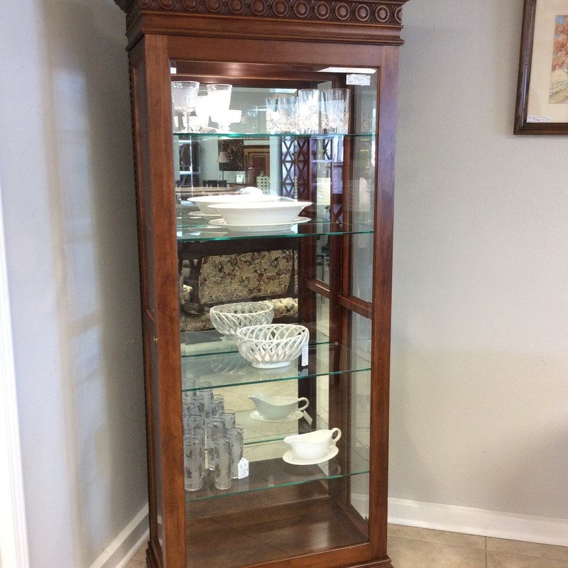 This curio cabinet features 4 adjustable shelves and interior lighting. Good condition.