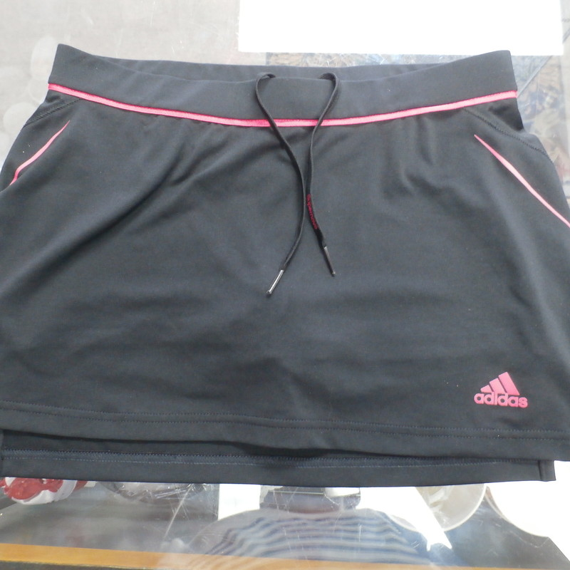 "adidas Women's Supernova Skort Skirt Size Small Black with pink #33535<br /> Rating: (see below) 3- Good Condition<br /> Team: Team<br /> Player: Team<br /> Brand: adidas<br /> Size: Women's     Small  -  (Measured Flat: Waist 13""; Length 12""; Inseam "")<br /> Measured flat: hip to hip; hip to hem; and groin to hem<br /> Color: black<br /> Style: elastic waist; Skort; Skirt;<br /> Material: 94% polyester 6%spandex<br /> Condition: 3- Good Condition: wrinkled; minor pilling and fuzz;<br /> Item #: 33535<br /> Shipping: FREE"