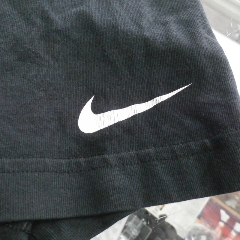 "Men's Nike Graphic Tee Shirt black Size Large short sleeve #33456<br /> Rating:   (see below) 4- Fair Condition<br /> Team:  N/A<br /> Player: N/A<br /> Brand:  Nike<br /> Size: Men's  Large (Measured Flat: across chest 19"", length 27"")<br /> Measured flat: armpit to armpit; top of shoulder to the bottom hem<br /> Color: Black<br /> Style: screen pressed; Short Sleeve;shirt;<br /> Material:  100% cotton<br /> Condition: - 4- Fair Condition - wrinkled; pilling and fuzz; some stretching from use; some discoloration; there are some spots on the shirt where the fabric is darker then others;<br /> Item #: 33456<br /> Shipping: FREE"