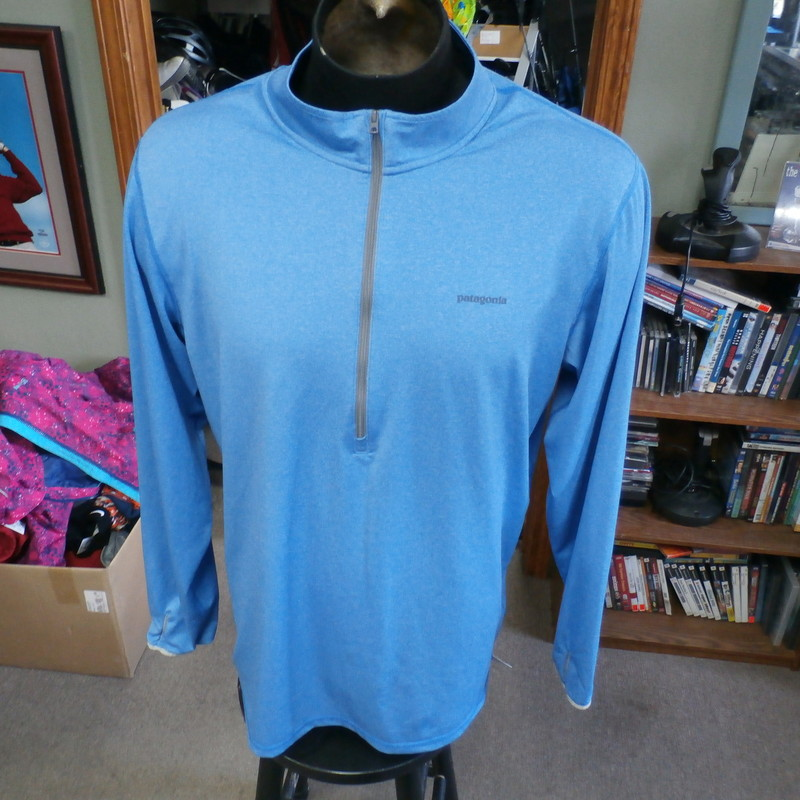 "Patagonia blue half-zip pullover size Large polyester blend #33736<br /> Rating: (see below) 3- Good Condition<br /> Team: n/a<br /> Player: n/a<br /> Brand: Patagonia<br /> Size: Men's Large- (Measured Flat: Across chest 24""; Length 30"")<br /> Measured Flat: underarm to underarm; top of shoulder to bottom hem<br /> Color: blue<br /> Style: long sleeve; screen printed<br /> Material: 94% polyester 6% spandex<br /> Condition: 3- Good Condition: minor wear and fading from use and washing; light stain on back left shoulder (see photos)<br /> Item #: 33736<br /> Shipping: FREE"