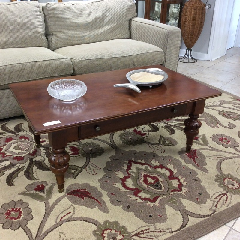 This coffee table is by Ethan Allen, it features turned legs and a single drawer with dovetail jointing.