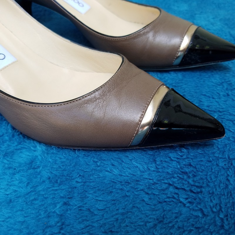 Amazing JIMMY CHOO Three Tone Kittens<br /> Excellent used condition<br /> New Cost $600.00<br /> Taupe and Black with Two Bronze Bands<br /> Box included<br /> Size: 37