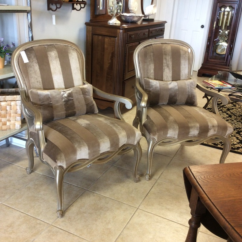 This pair is classic and elegant! These armchairs by Century have been upholstered in a soft, velvety fabric with a bold stripe of champagne and cocoa. Extra wide seating for comfort. The frame of the chairs have been painted and antiqued in gold to give them a vintagy look and feel. Check out the back of these chairs, they're just as pretty!