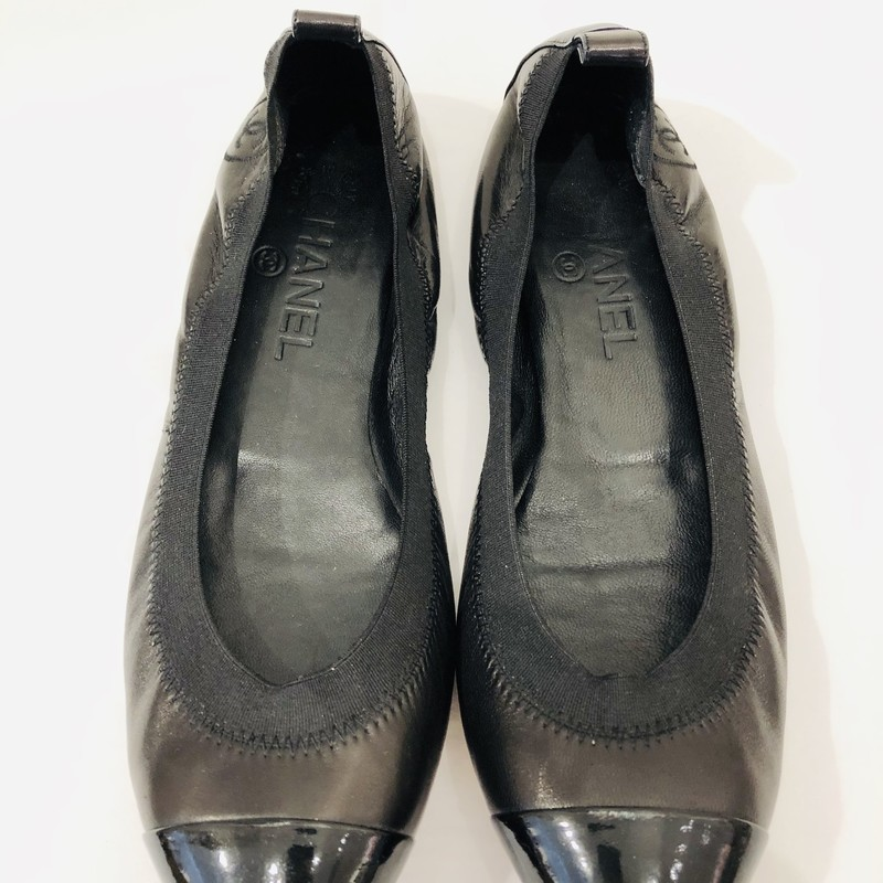 "Chanel all black flats, black patent cap toe (one toe shows some white marks, see image)<br /> <br /> Elastic fit, ""CC"" stitched on side<br /> <br /> Size 38.5"