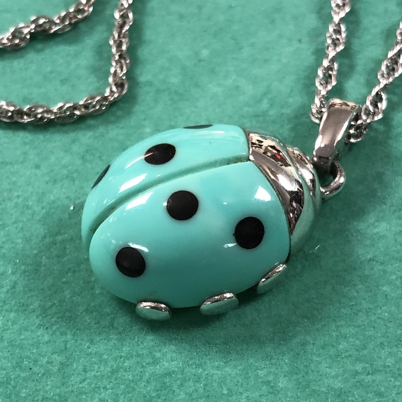 "Trifari Ladybug Necklace<br /> Color: Silver, Aqua, Black<br /> Ladybug measures 7/8"" wide x 1"" long (1.5"" long including hanger)<br /> Silver plated chain measures 22"" long"