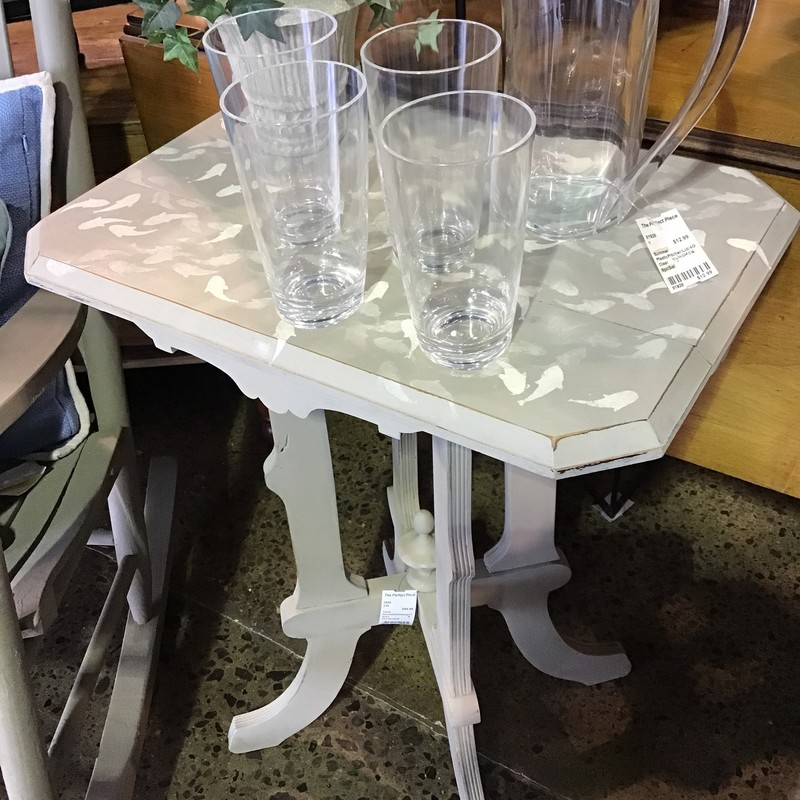 "This vintage table has been updated with gray paint and fish stenciled on top by one of our local artists! Perfect conversation piece for any room of your home!<br /> Dimensions are 22"" x 16"" x 29-1/2"""