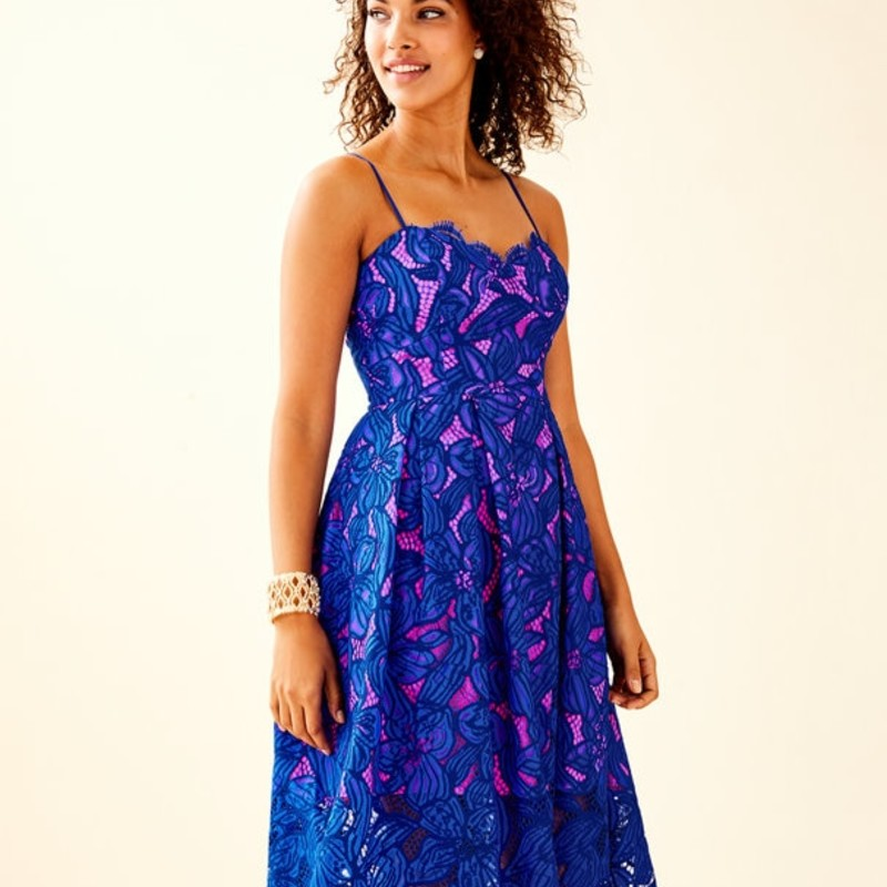 "NWT Lilly Pulitzer Camella Dress, royal orchid two tone lace, Size: 4, orig. rtl: $298<br /> <br /> ""<br /> This dress is the life of the party with its two-tone orchid lace and removable flower pin. We put a new twist on the classic fit and flare body with spaghetti straps, an exposed metal zipper, and just the right pop of color. We have a feeling just getting ready will already have you in the dancing mood!<br /> <br />     Strappy Lace Fit And Flare Dress With Pop Color Lining, Bodice Cups, Exposed Back Metal Zipper And Removable Flower Pin.<br />     41"" From Top Of Shoulder To Hem.<br />     Length: Midi.<br />     Two Tone Orchid Lace (60% Polyester, 40% Nylon).<br />     Hand Wash Cold. Separately. Line Dry.""<br /> <br /> PHoto and description credits: lillypulitzer.com"