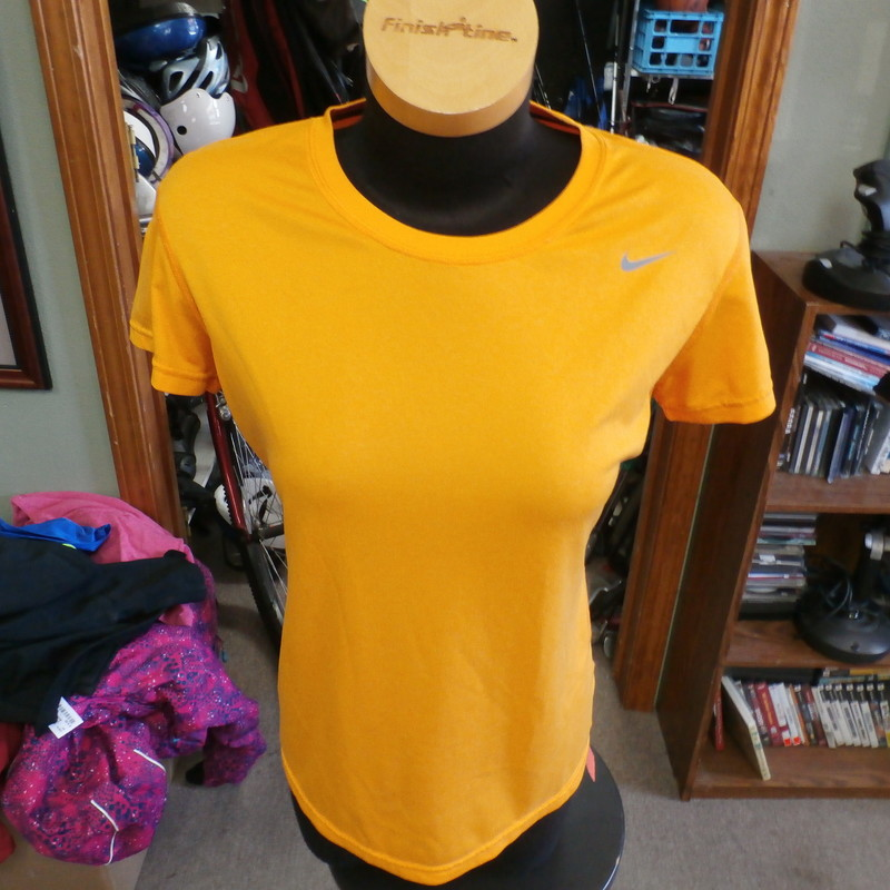 "Nike Dri-Fit women's athletic shirt orange size medium 100% polyester #14491<br /> Rating: (see below) 2- Great Condition<br /> Team: n/a<br /> Player: n/a<br /> Brand: Nike<br /> Size: Women's Medium- (Measured Flat: Across chest 19""; Length 25"")<br /> Measured Flat: underarm to underarm; top of shoulder to bottom hem<br /> Color: orange<br /> Style: short sleeve; screen printed<br /> Material: 100% polyester<br /> Condition: 2- Great Condition: gently used (see photos)<br /> Item #: 14491<br /> Shipping: FREE"