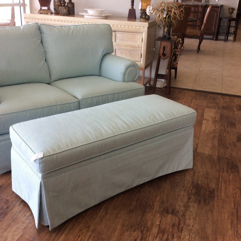 ANOTHER BASSETT STUNNER! This opptman came in with a GORGEOUS matching loveseat, that is available for purchase seperately. The aqua and white sailcloth upholstery has been fully treated with FABRIC GUARD