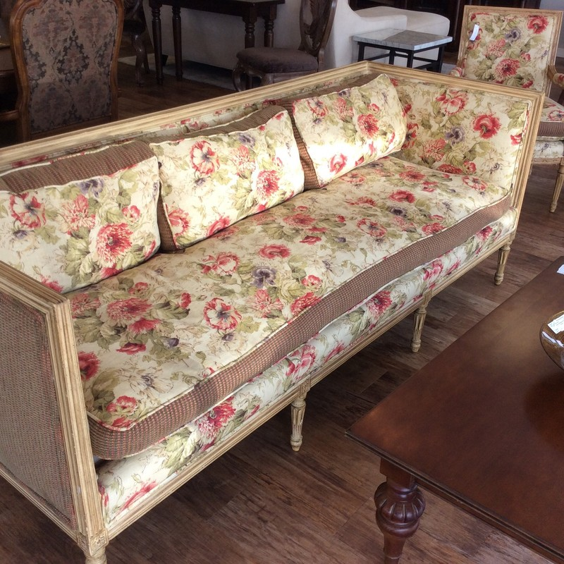 This gorgeous sofa is by SUNILAND FURNITURE out of Neptune, New Jersey. The solid wood frame has lovely carved details, and an antiqued yellow finish. The seat and back pillows are ALL down filled, and feel quite luxurious. There are also 2 matching arm chairs, that are available for purchase seperately.