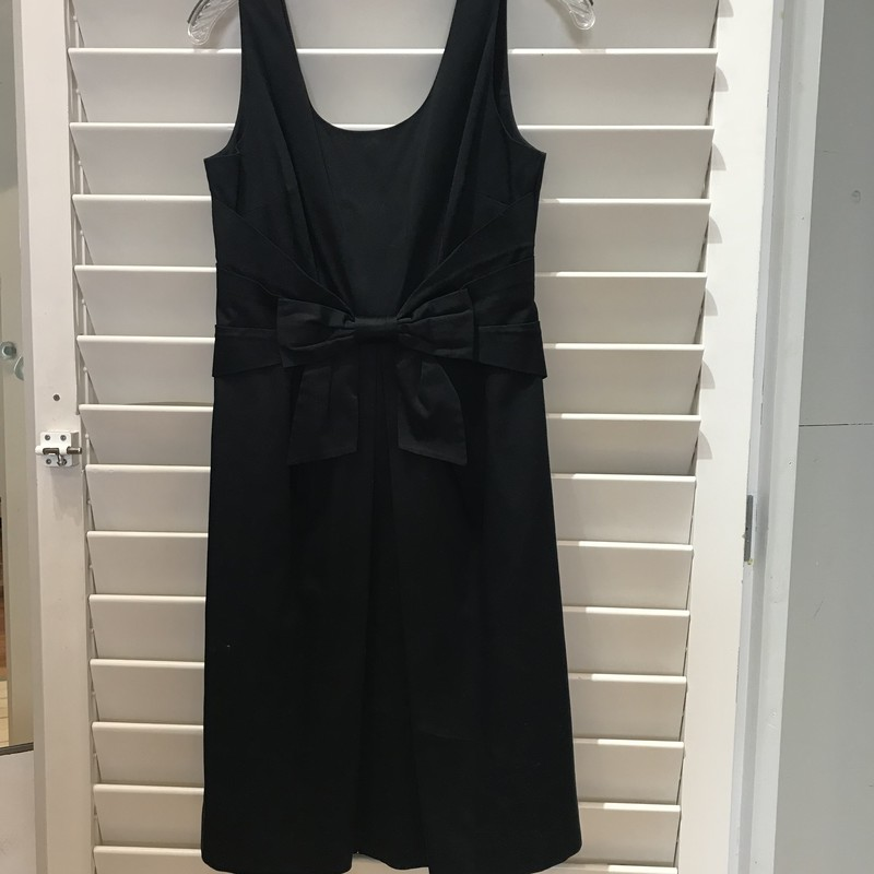 Kate Spade sleeveess Black dress with nipped in waist and bow detail at the front. Size: S