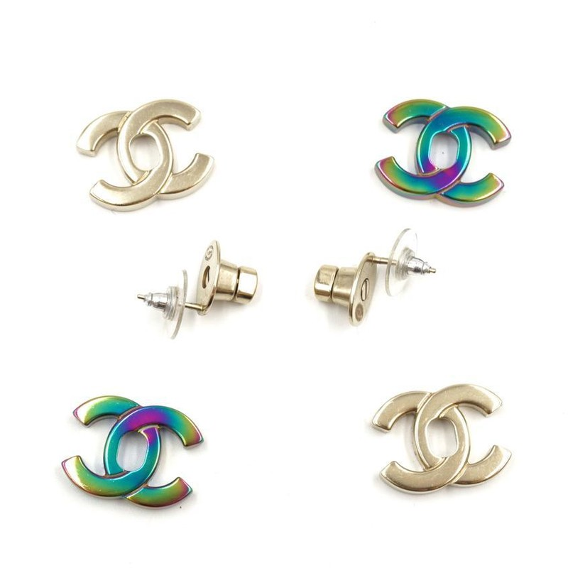 Chanel Gold 18c Turn Lock In 1 Earrings , CC, Irridescent<br /> <br /> Brand New Chanel Turn Lock Earrings in Gold and Iridescent 2 in 1, interchangeable.