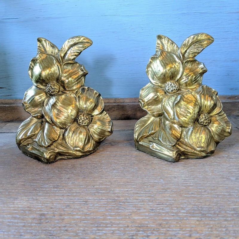 "Brass Flower bookends stamped 1965<br /> <br /> 5.5"" Tall<br /> <br /> Call or text the shop for shipping options!"