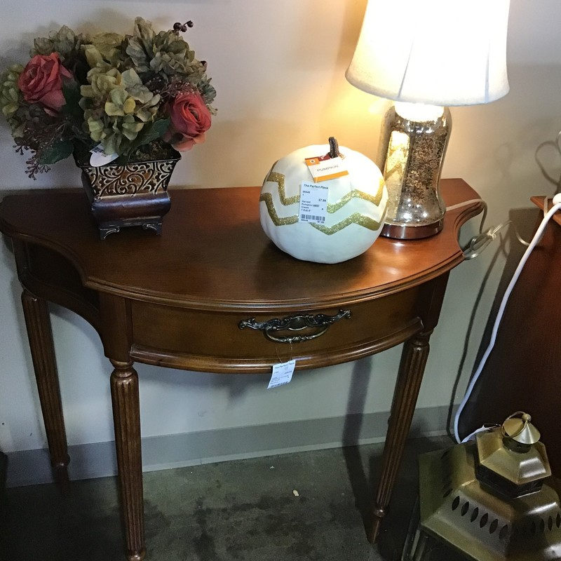 "Are you looking for a small demilune table for that specific space in your home? Check out this one by Bombay that has a drawer for storage and is in great condition.<br /> Dimensions are 35"" x 15"" x 30"""
