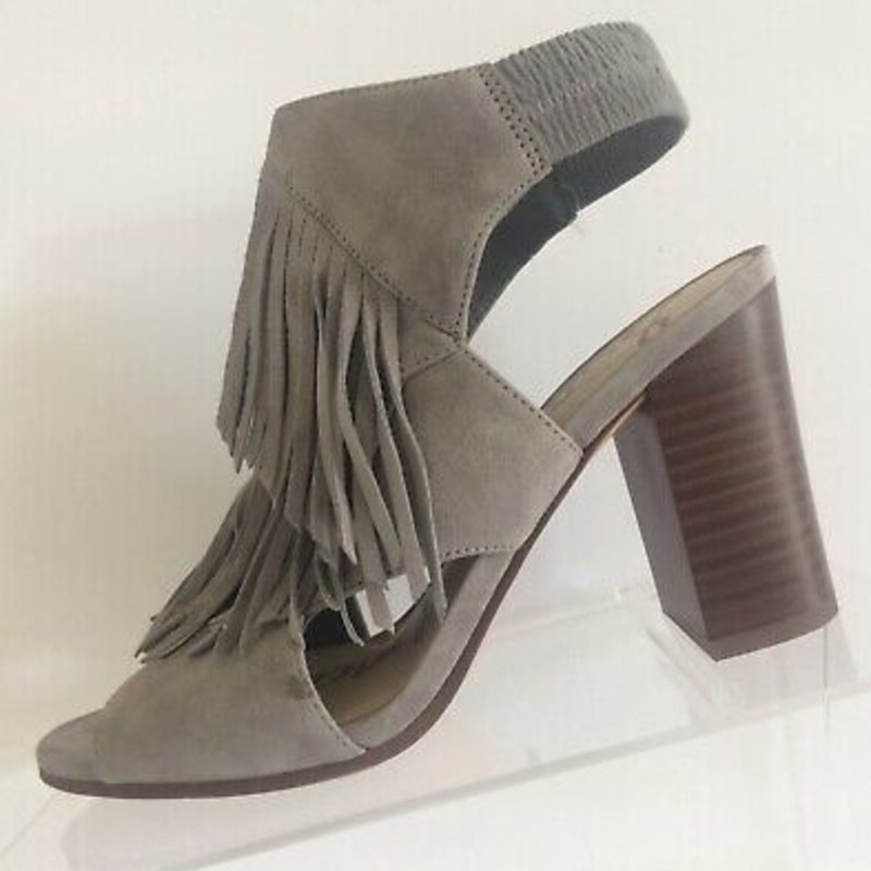 "Sam Edelman Elaine Suede Heels, Grey, Size: 10, orig. rtl: $140, EUC<br /> <br /> ""Tiered fringe adds a dramatic Western flourish to an open-toe sandal shaped from lush suede and set on a lofty stacked heel.<br /> <br /> Sizing: Runs large; if between sizes, order one size down.<br /> <br /> - Round open toe<br /> - Fringed vamp<br /> - Slip-on<br /> - Open back<br /> - Approx. 3.5"" heel<br /> - Imported""<br /> <br /> Photo and description credits: nordstromrack.com"