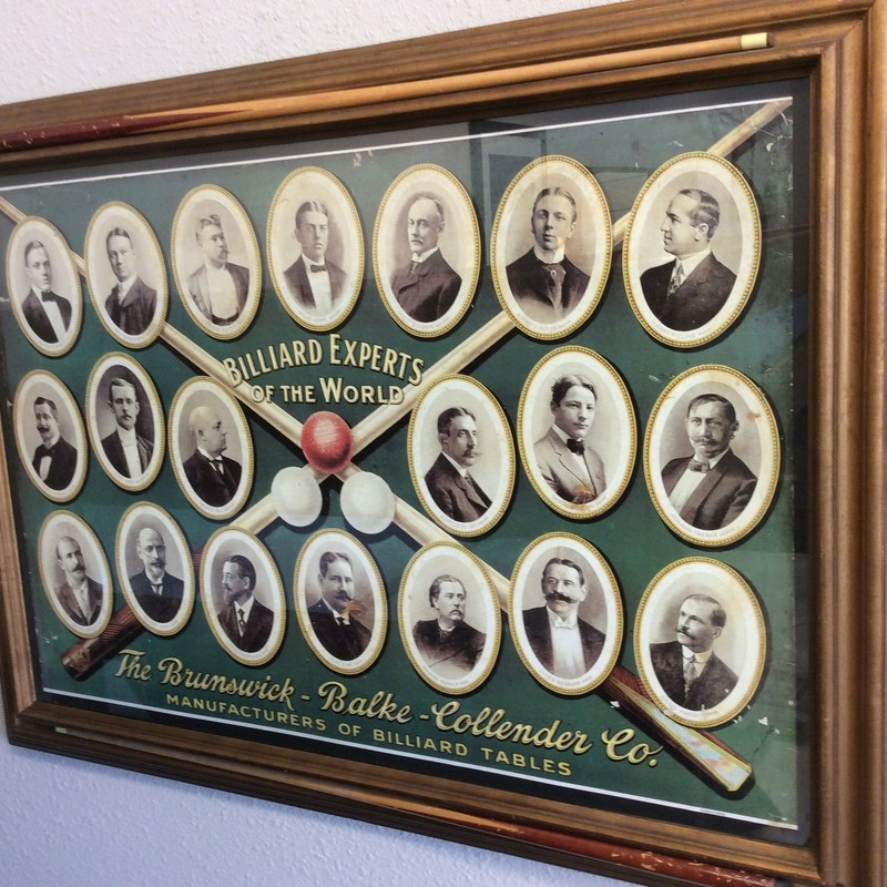 Wow, this piece is more than 100 years old. The poster itself is from 1915, and was produced by THE BRUNSWICK-BALKE-COLLENDER CO. The unique frame includes the addition of 2 pool cues. Stop by and check it out!