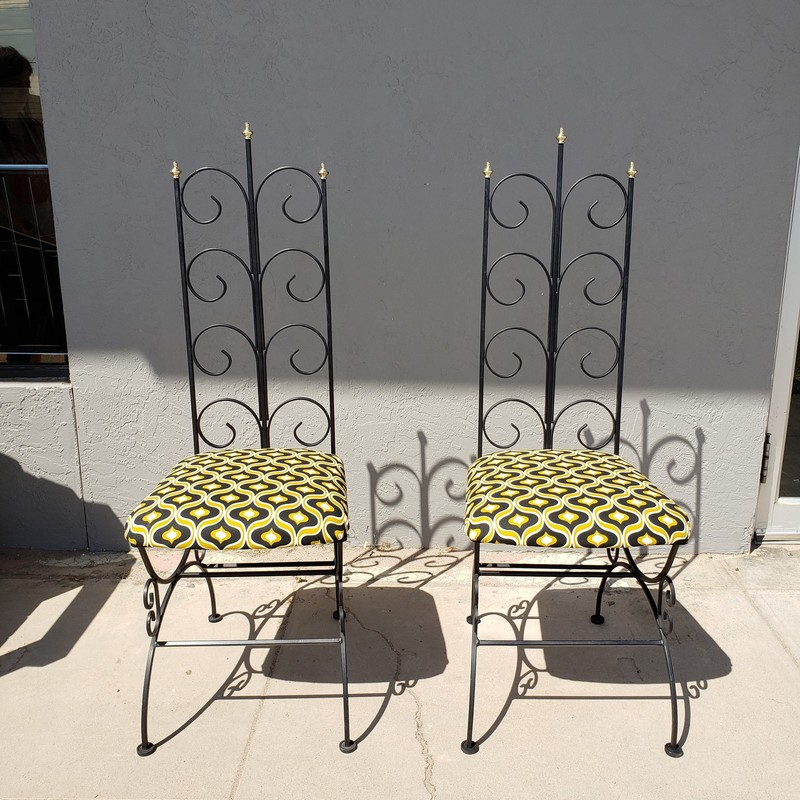 "2 high back metal scroll chairs with new upholstery<br /> <br /> Black<br /> <br /> Size: 44.5"" tall"